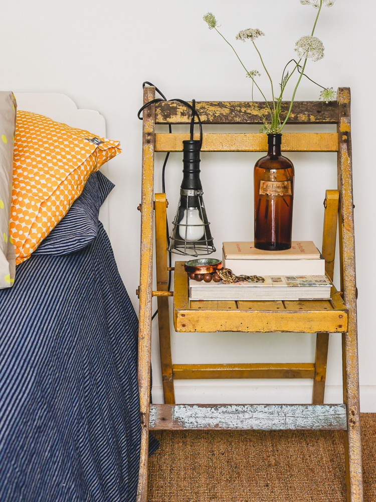 vintage chair as bedside table